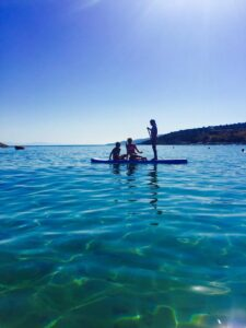 McConks 10'8 inflatable paddle board (iSUP) in the warm, azure waters of the Mediterranean Sea